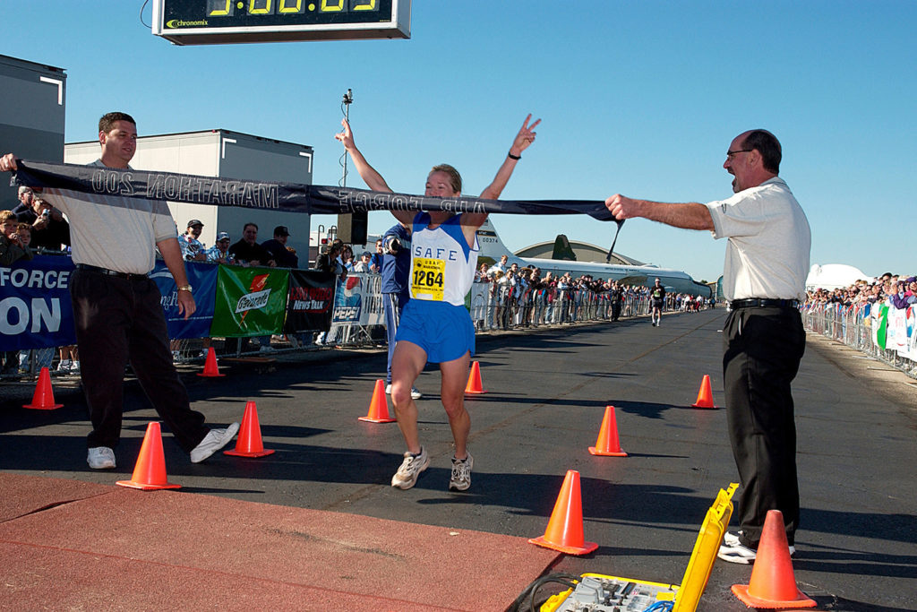Jill Metzger coming across the finish line to win the Marathon for the female division at Wright-Patterson Air Force Base Marathon for 2004. Start a good habit.