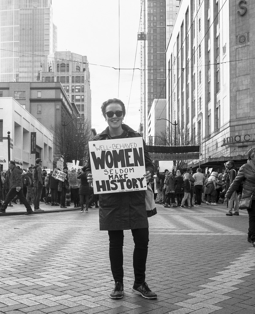 A woman holding a placard.