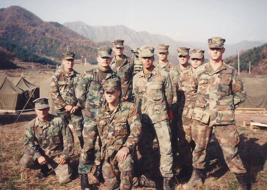 Larry Sharpe in marine uniform with his platoon members.